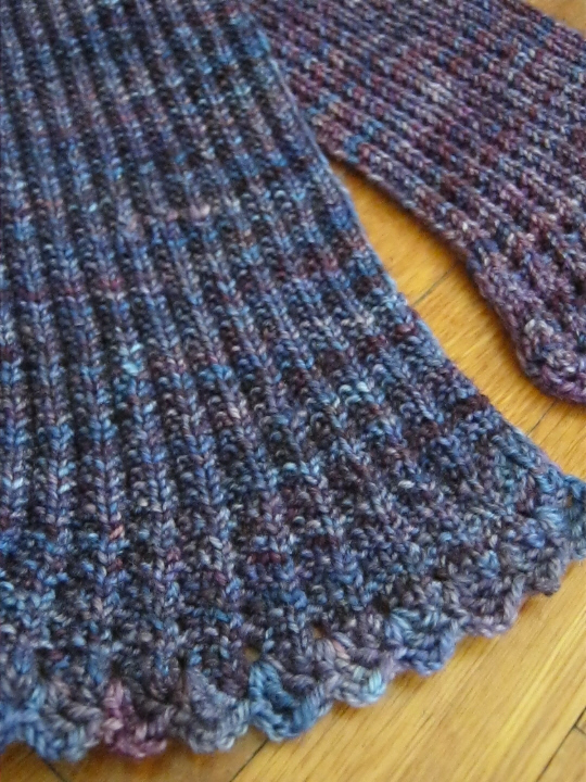 Ribbed scarf with crocheted edging detail