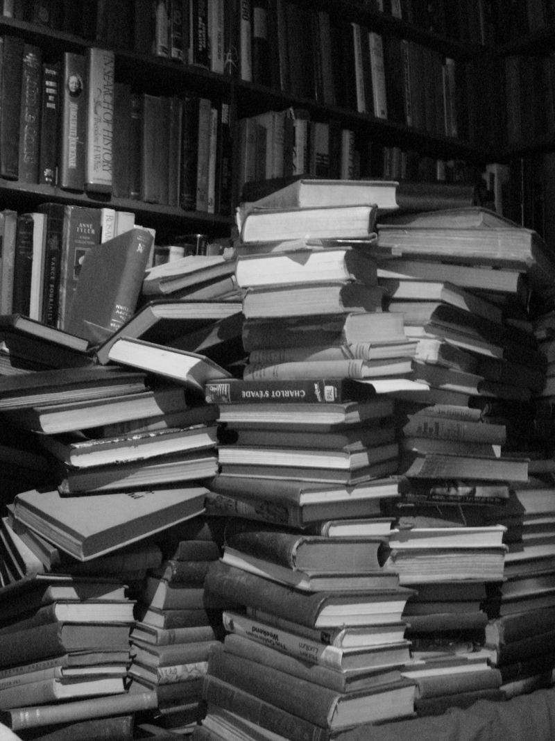 Books in a stack - evan lawrence bench