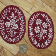 A Pair of Floral Rugs